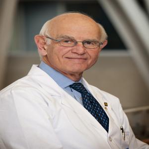 Dr. Charles H. Tator